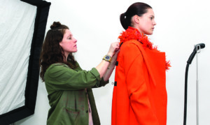 Fashion Designer Fitting Model Orange Coat