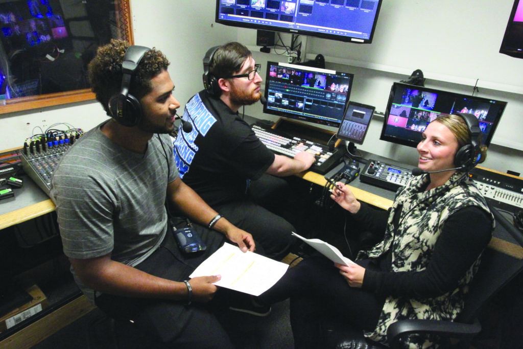 communications students in media booth
