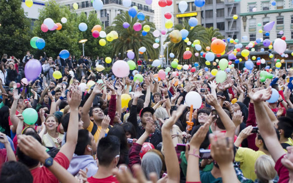 students-throwing-balloons-in-air