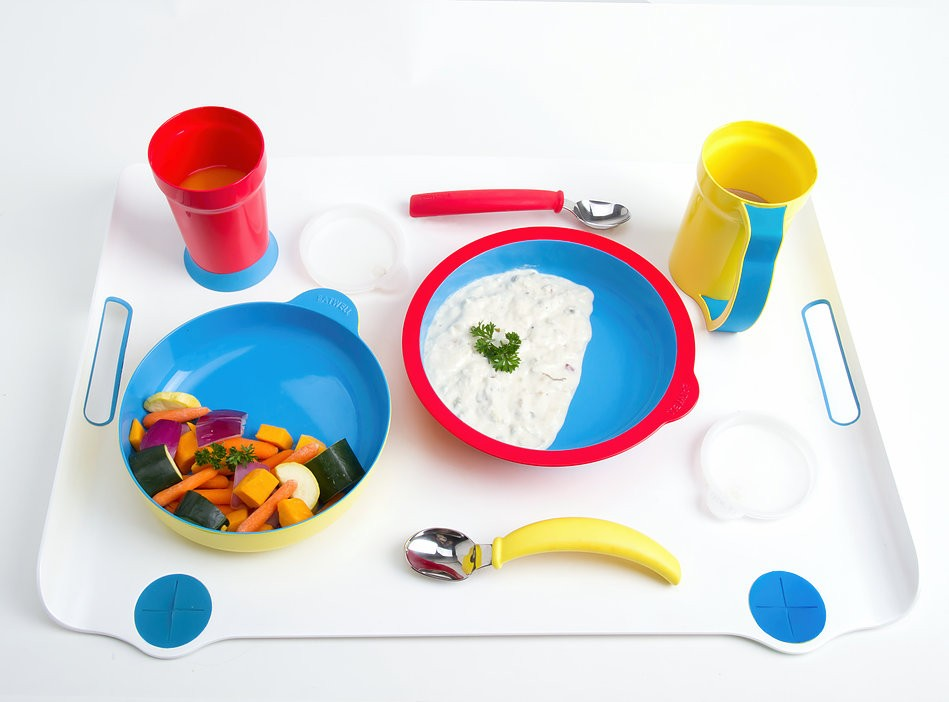 An image of bowls, cups, and eating utencils that are all brightly colored