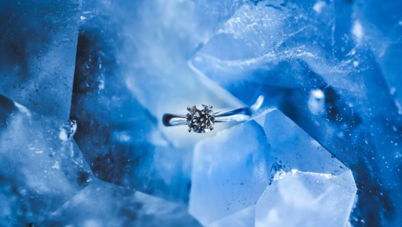 silver diamond ring on a blue hunk of ice