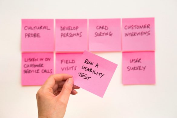 Web design brainstorming with post-its on a wall