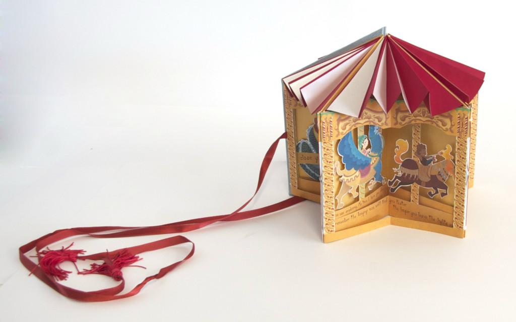 Pop-out book shaped like a carousel
