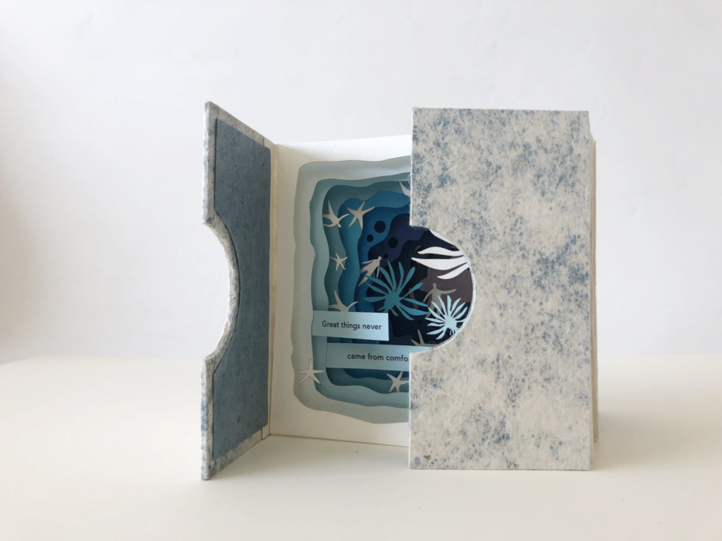 Image of a book with cut-out pages