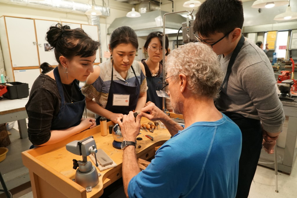 Professor demonstrating jewelry and metal arts techniques