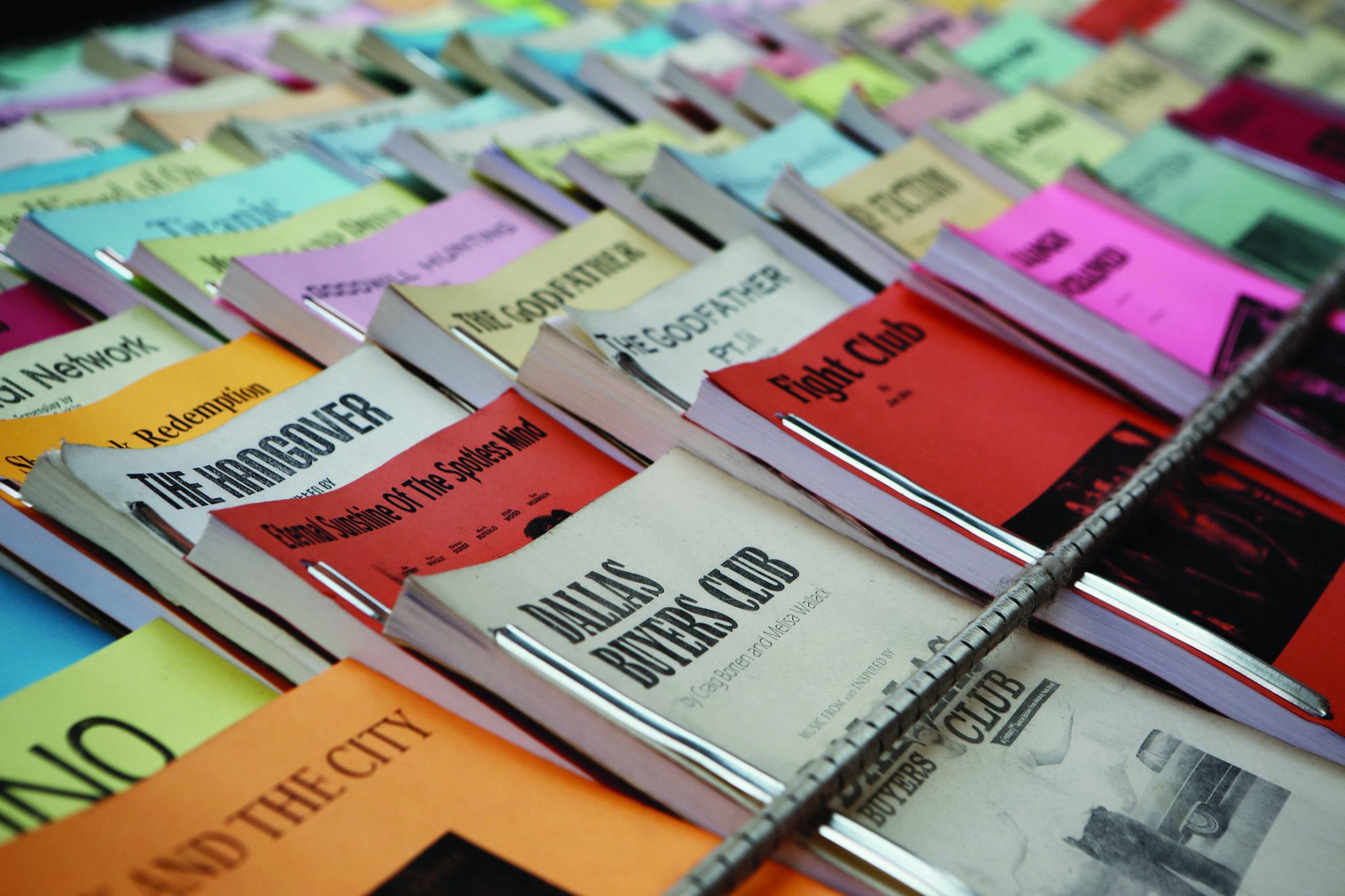 Screenplays laid out on table