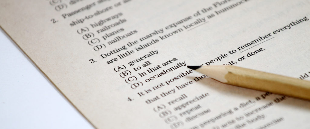 Pencil sitting on top of a multiple choice test