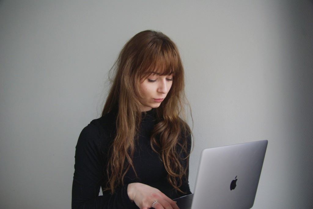 Woman working on a Mac laptop