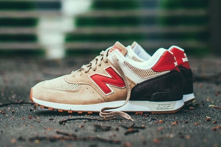 White New Balance 576 sneakers with red and black detailing