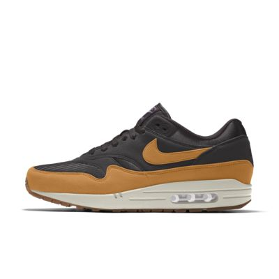 Black, white, and gold Nike Air Max 1 sneaker