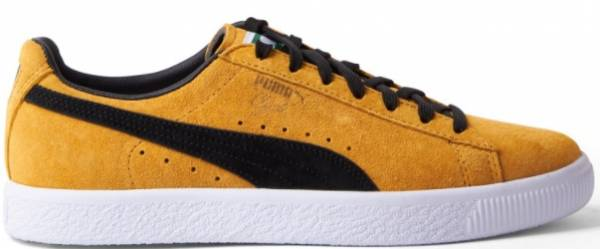 Gold and black Puma Clyde sneaker