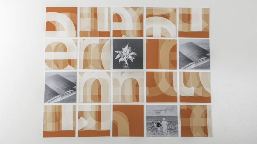 Orange and white wall art piece made up of multiple squares by Hai Trieu Le